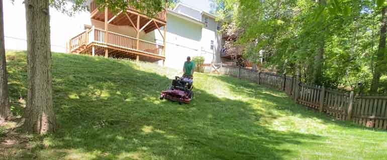 Mowing A Steep Hill With a Handheld Mower