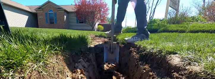 diging a trench for drainage pipe
