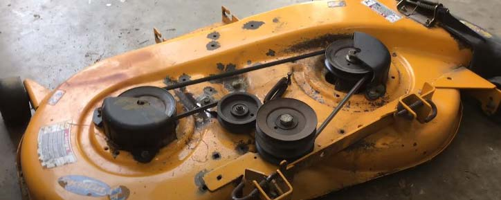 how to adjust belt tension on riding lawn mower