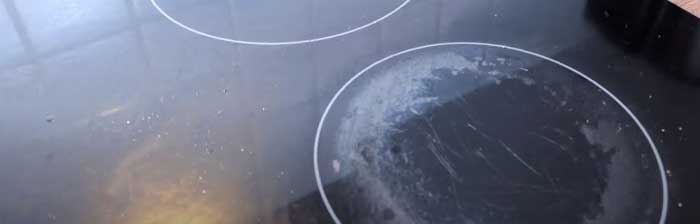 how to remove cloudiness from glass top stove